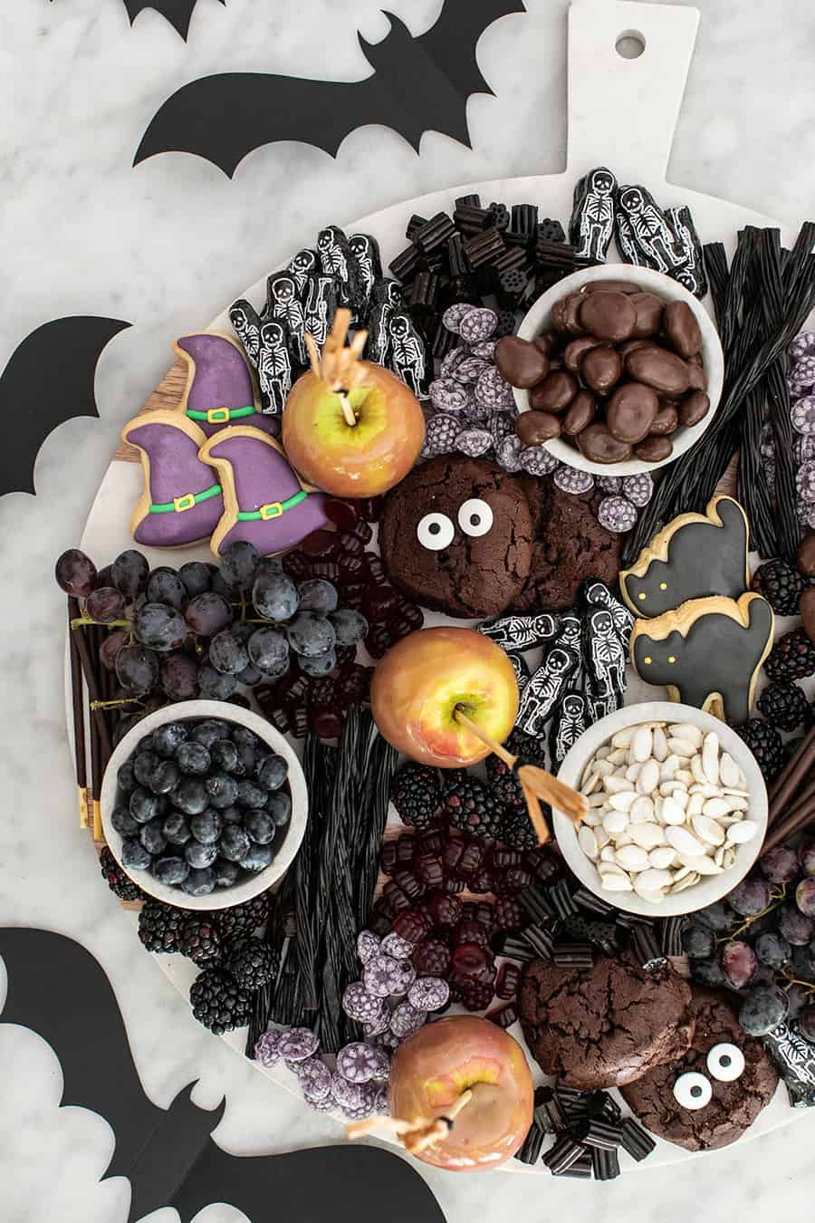 Halloween dessert with candy and fruit.