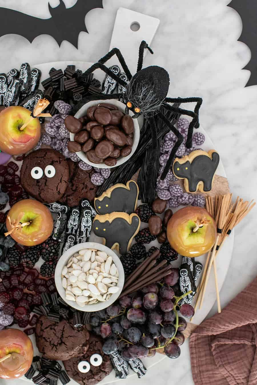 Board full of Halloween treats from cookies to caramel apples, candies and more!