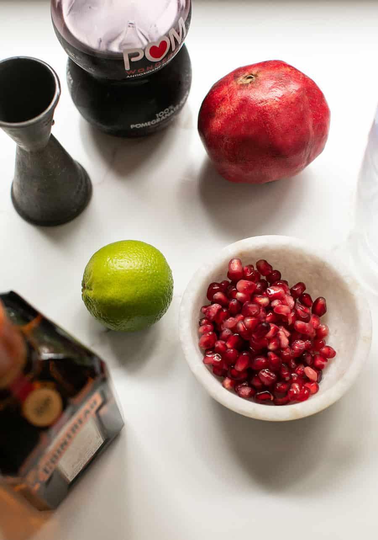 Ingredients to make a pomegranate margarita