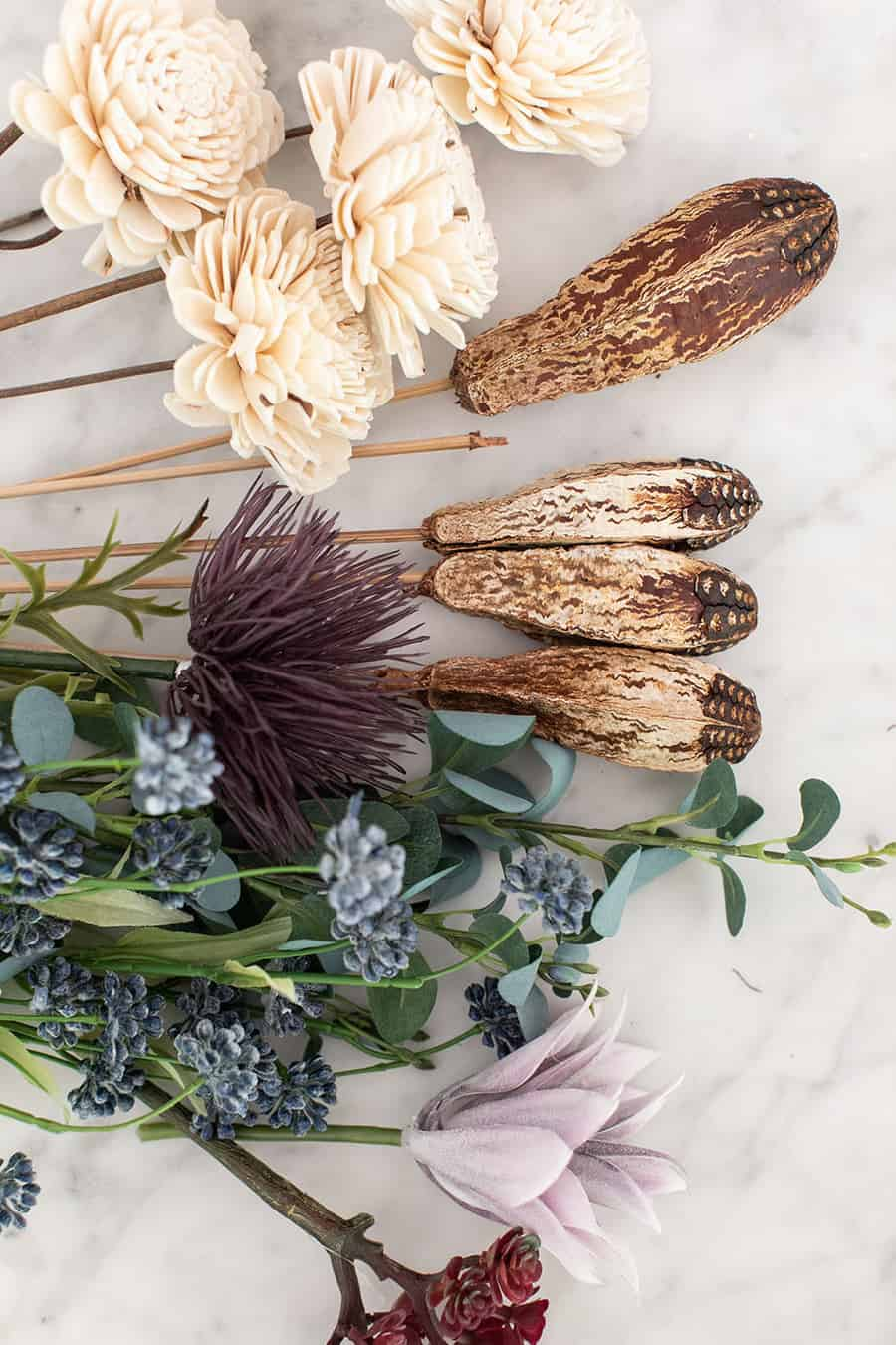 Dried and faux flowers on a marble table