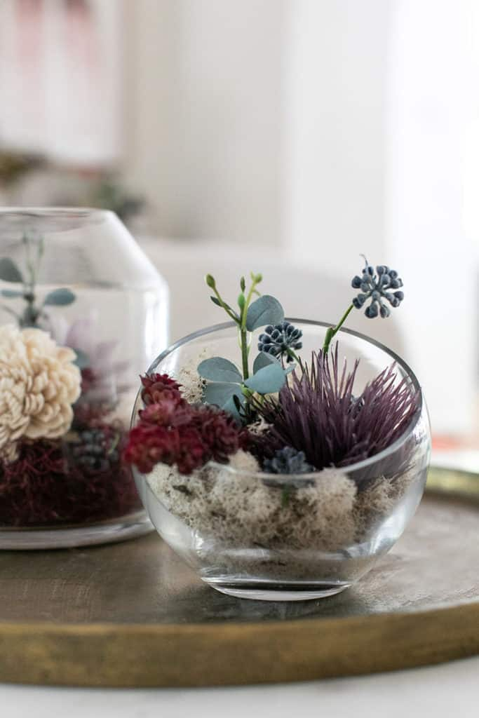 Fall glass terrarium on a gold tray