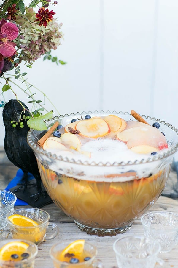 Apple Cider Punch with apple ring and cinnamon sticks in a punch bowl.