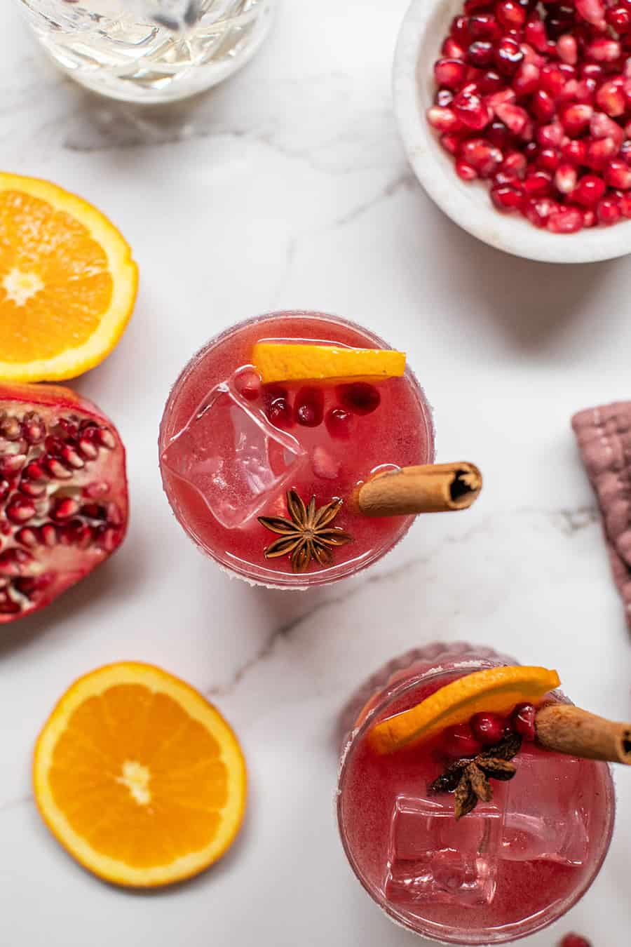 Pomegranate margaritas with cinnamon sticks and star anise.