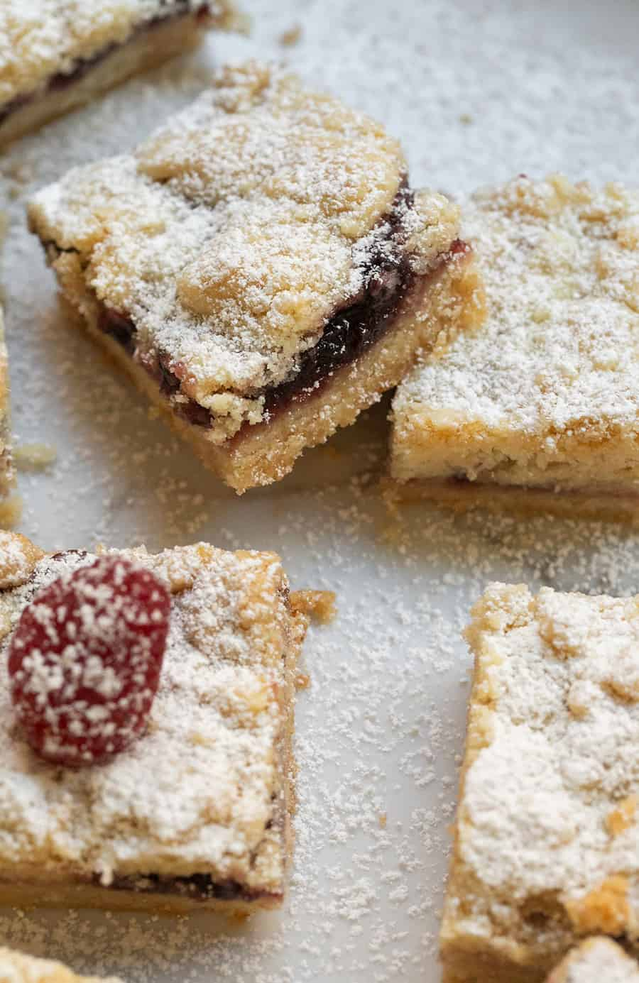 Shortbread cookie crumble bars with raspberry preserves.