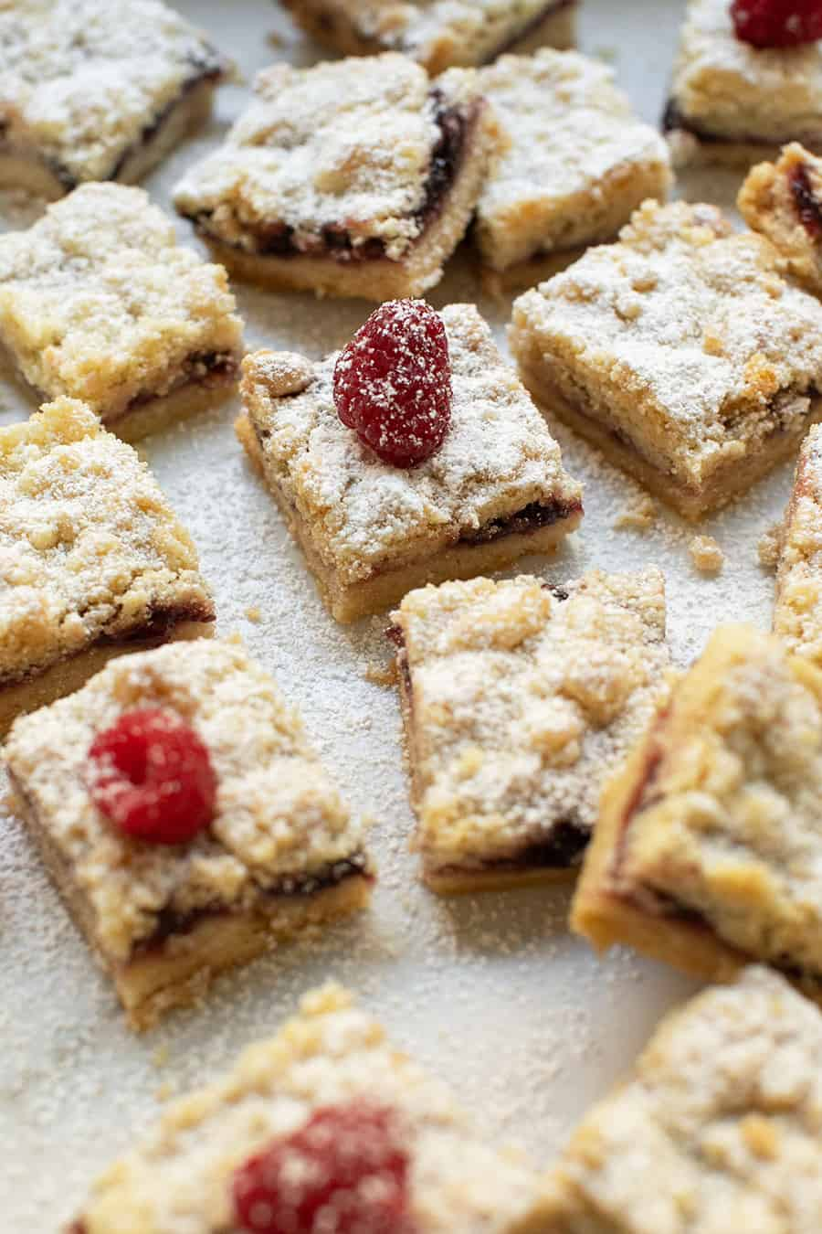 Shortbread bars filled with raspberry preserves, dusted with powdered sugar.