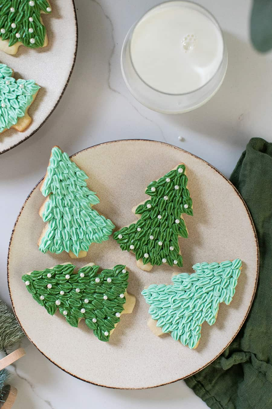 Tree Christmas sugar cookies, with green frosting and sprinkles.