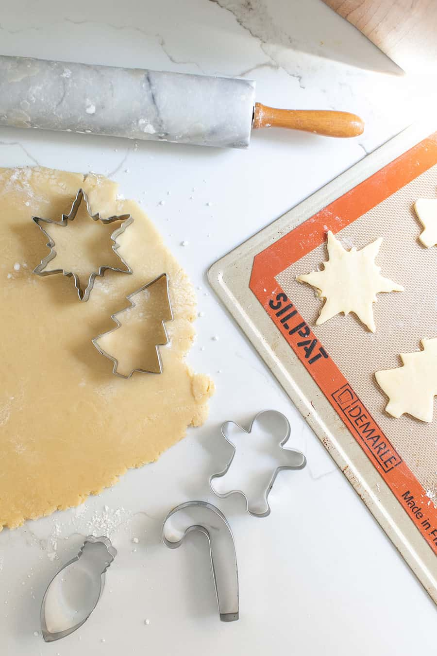 Rolling out Christmas sugar cookies.