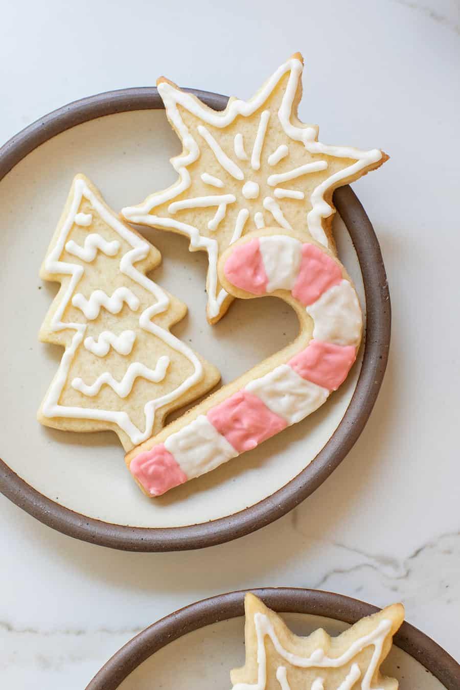 Sugar-free cookies shaped like a candy cane, Christmas tree and snowflake.