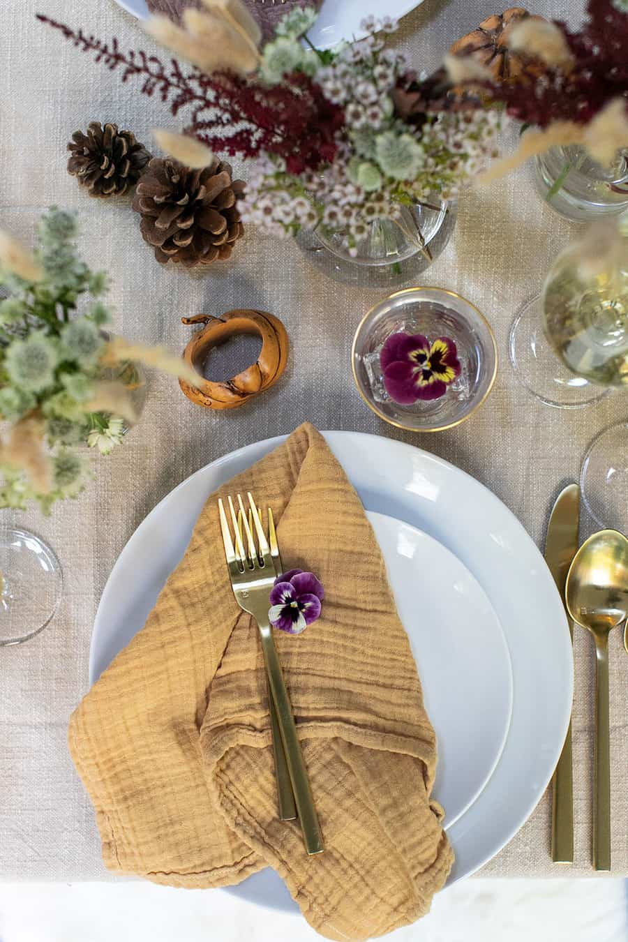 Yellow crinkle napkin from Food52 and gold flatware from Fortessa and Williams Sonoma