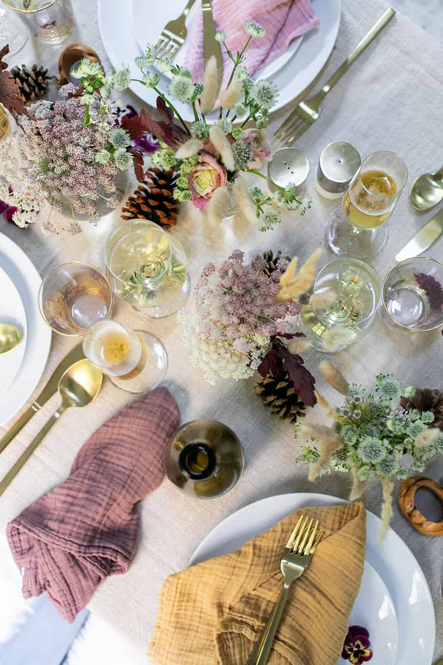 Thanksgiving table setting with flowers, wine and Champagne