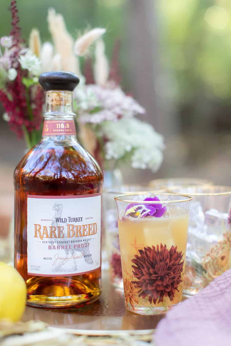 Wild Turkey Bourbon cocktail in a floral cup.