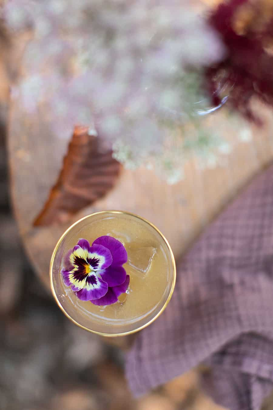 Bourbon cocktail with an edible flower.
