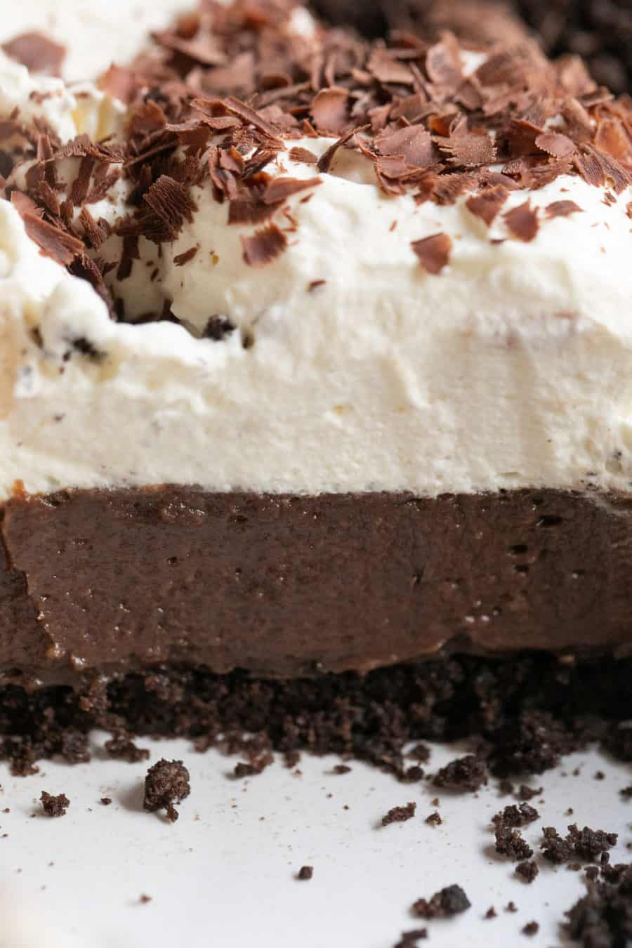 Layers of chocolate pie and crumb crust with whipped cream