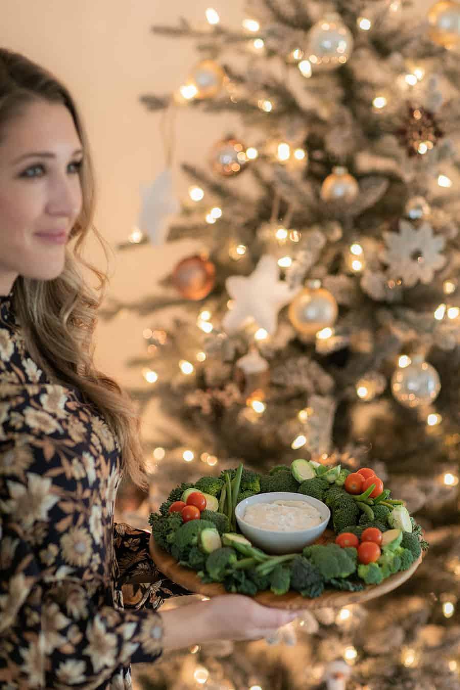 Eden Passante holding a Christmas food wreath