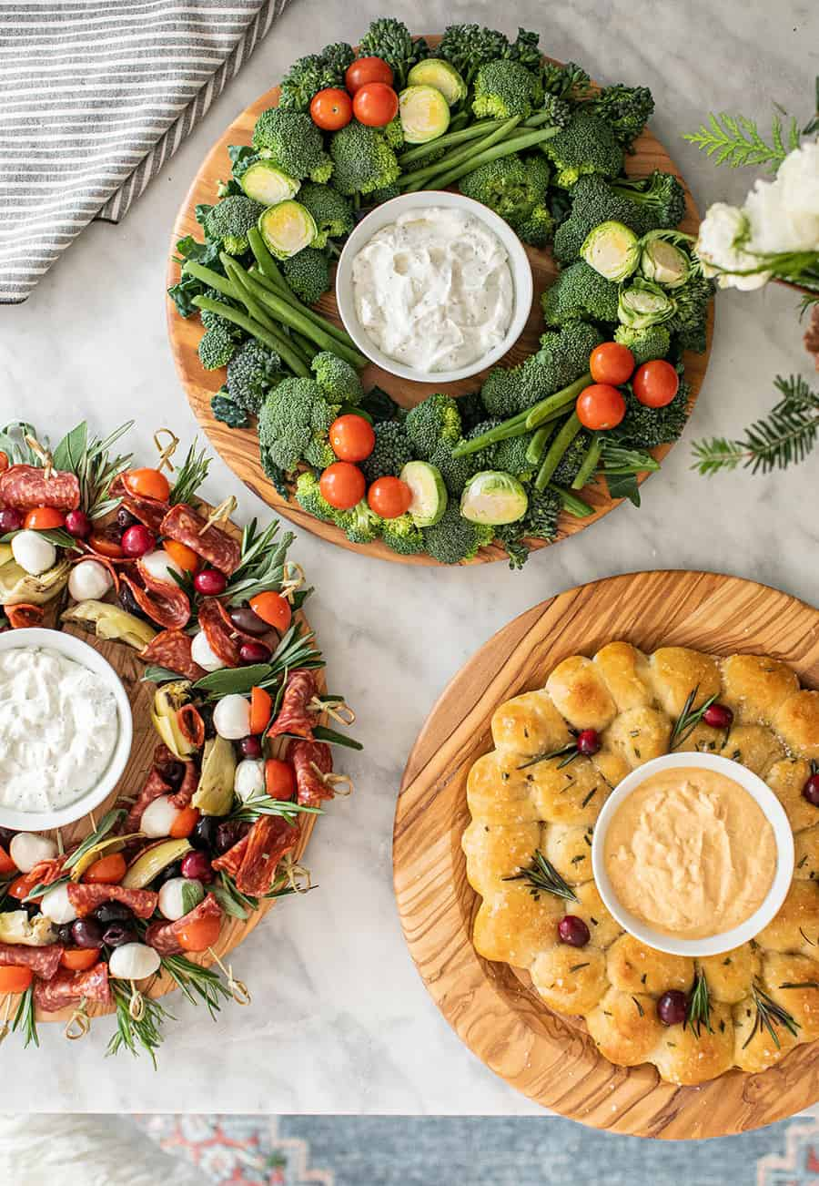 Easy Christmas appetizers on wooden boards.