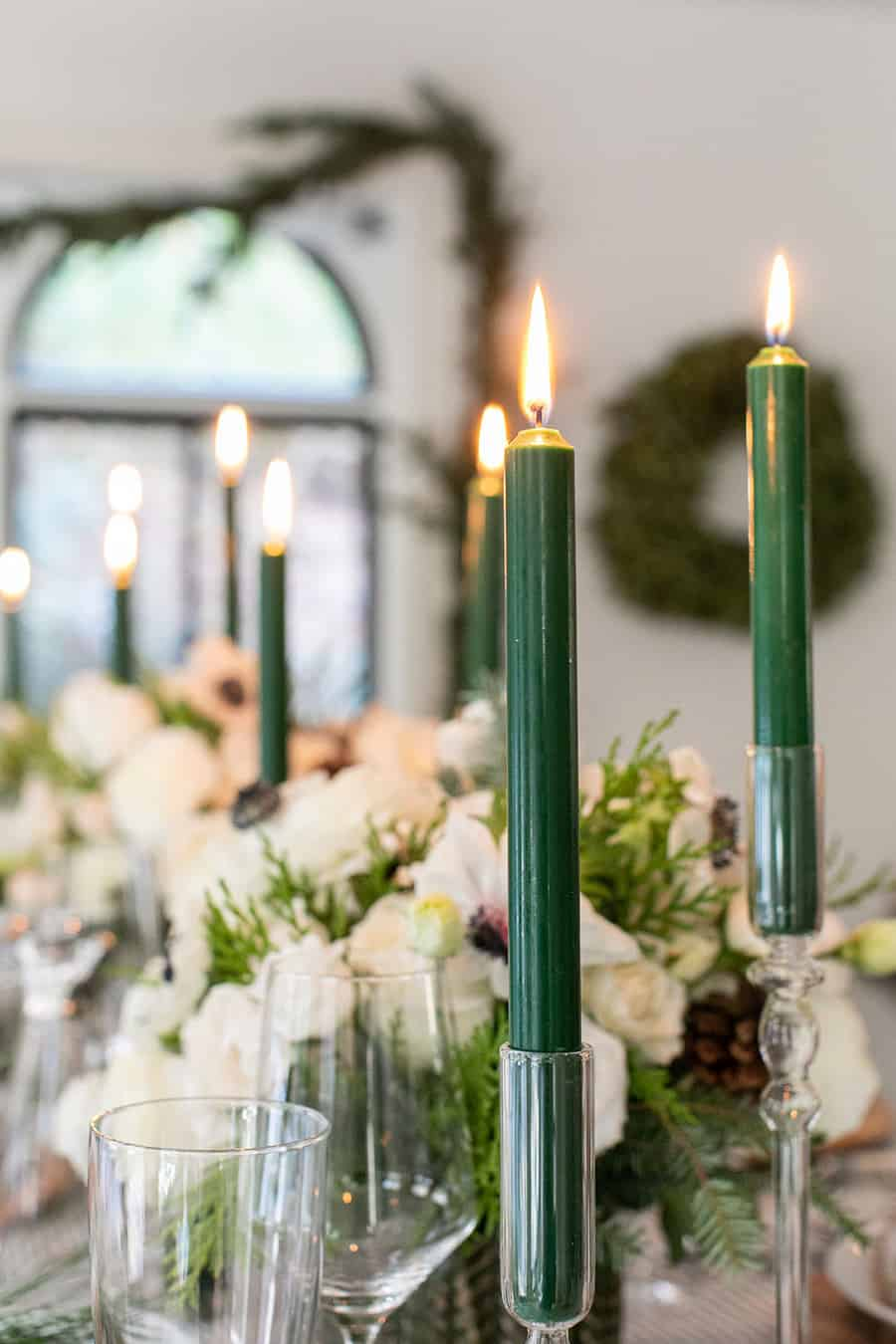 Green candles in candle holders.