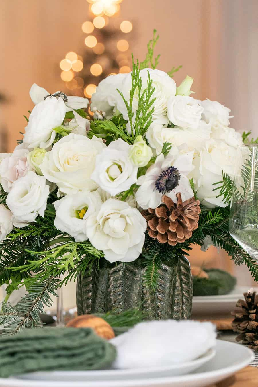 Christmas flowers in a a green Hobby Lobby vase.