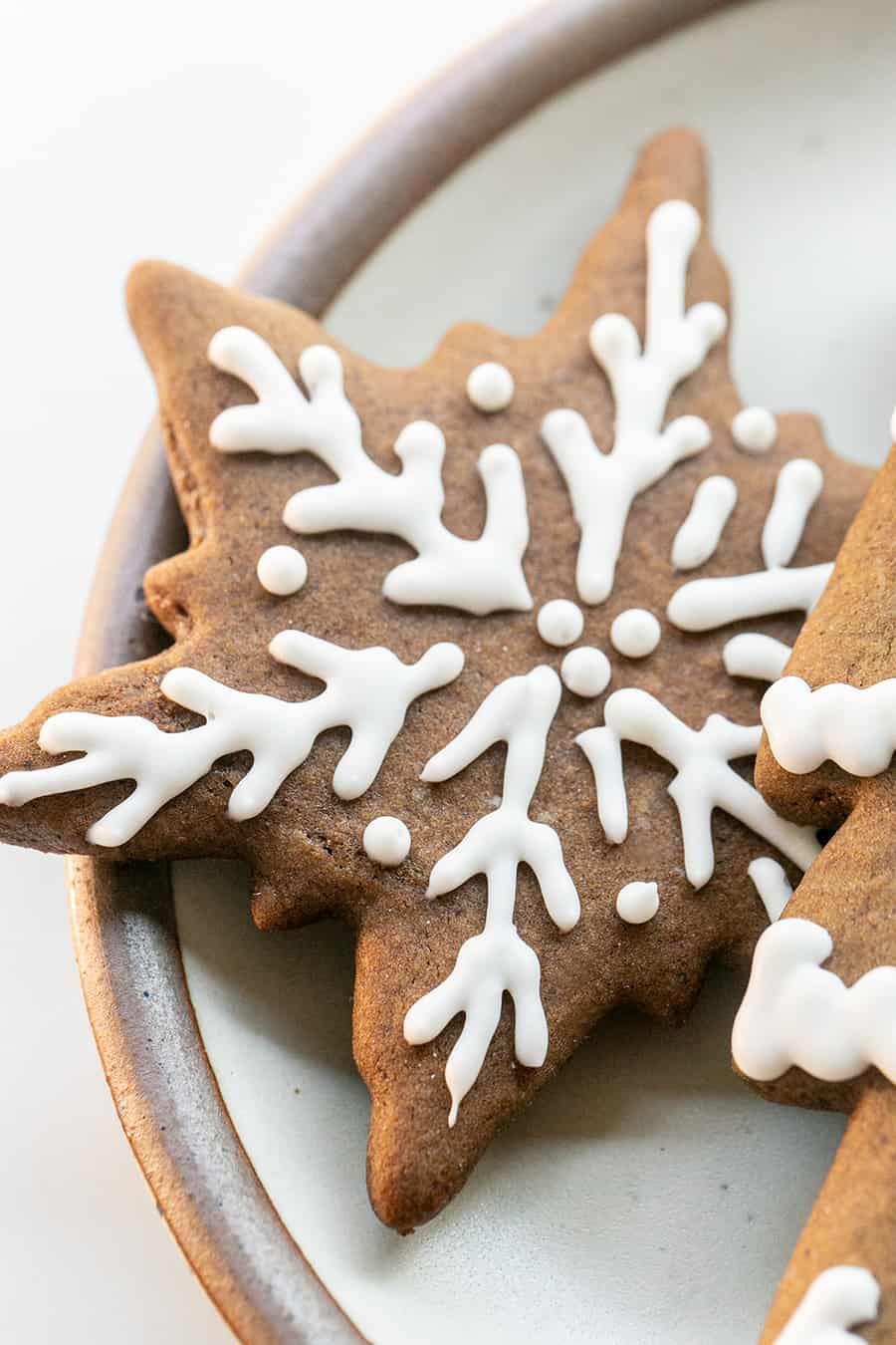Gingerbread snowflake cookie decorated with royal icing