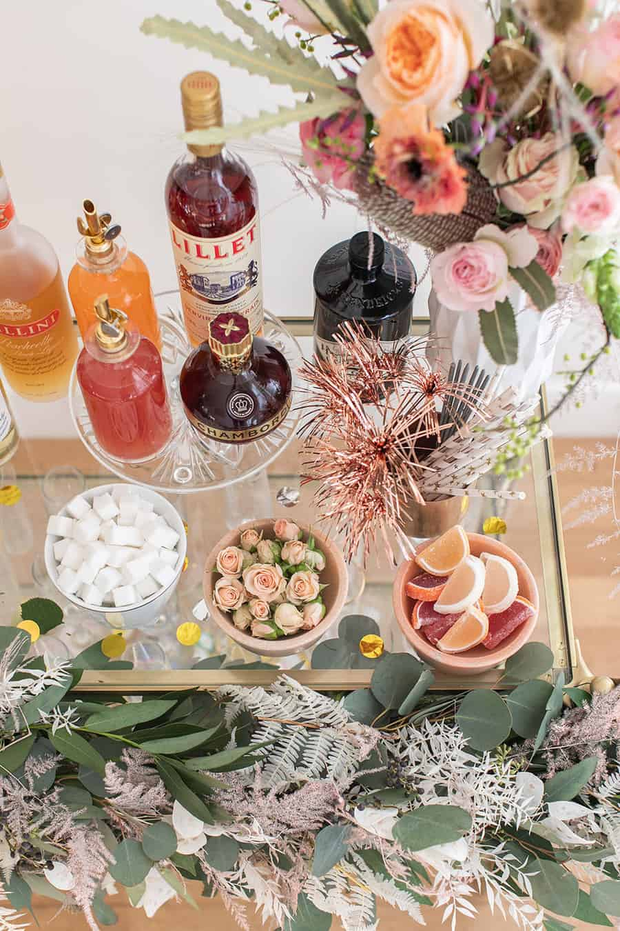 Bar with gin, toppings, sparklers and flowers for a New Year's Eve Champagne Bar