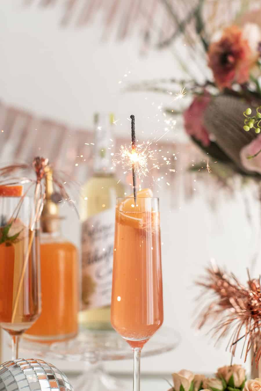 Champagne cocktail with a sparkler.