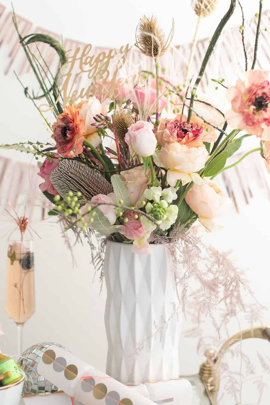 Flowers for New Year's Eve in a white vase