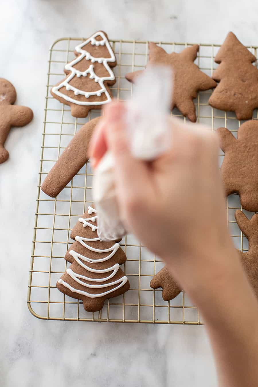 Decorating gingerbread cookies with royal icing