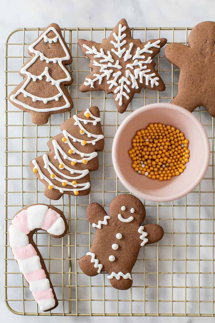 Gingerbread cookies decorated on a cooling rack