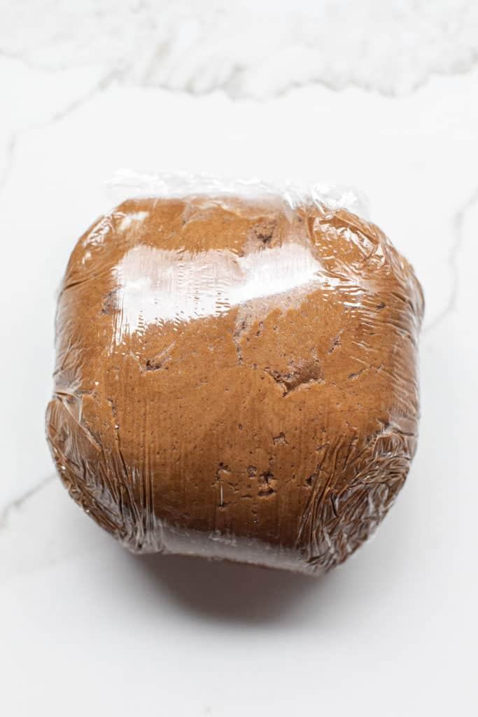 Gingerbread cookie dough wrapped in plastic