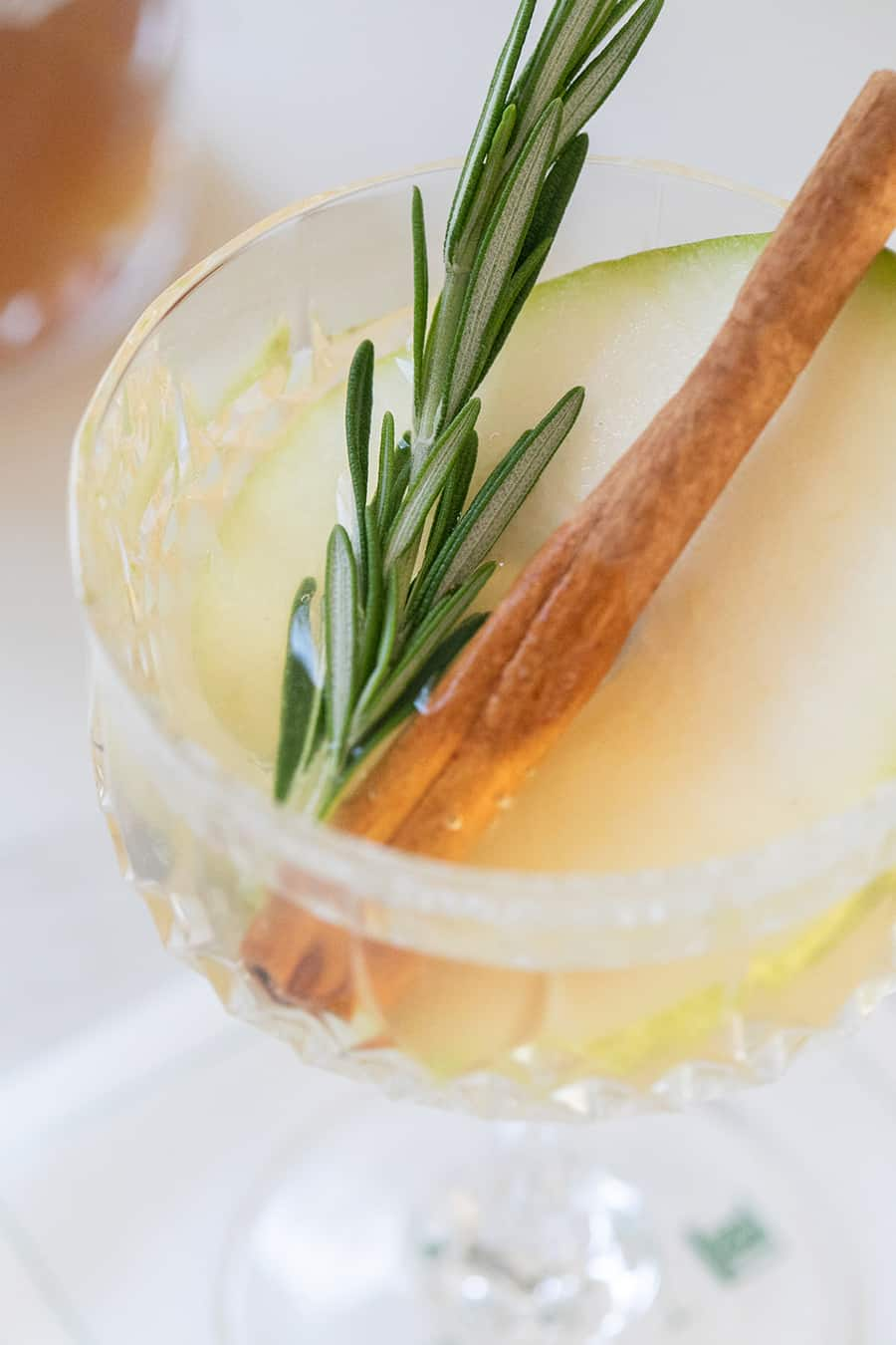 Partridge in a pear tree cocktail with rosemary and a cinnamon stick.