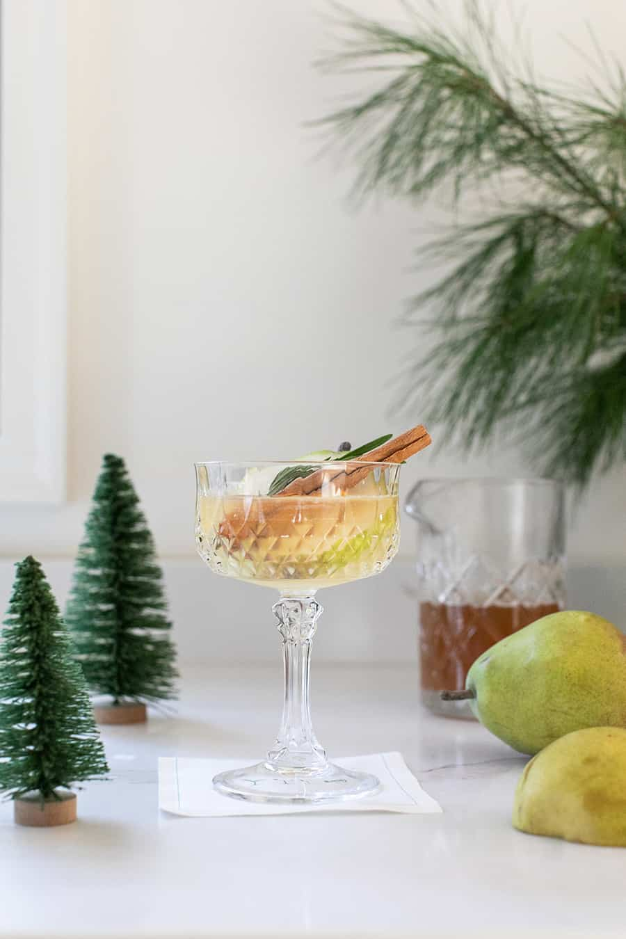 Christmas cocktail with pear, gin and cinnamon