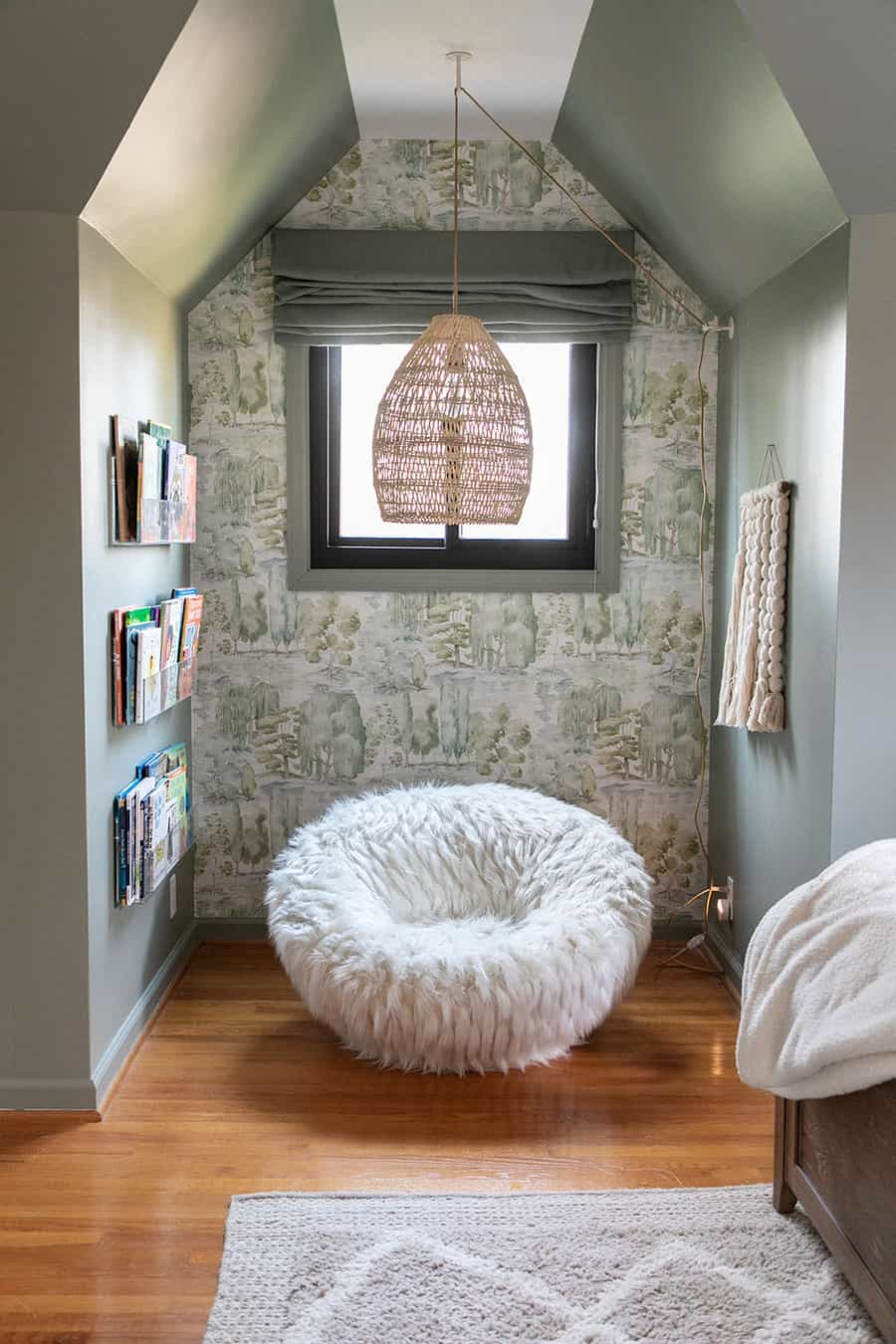Pottery barn swivel chair with a light in a reading nook