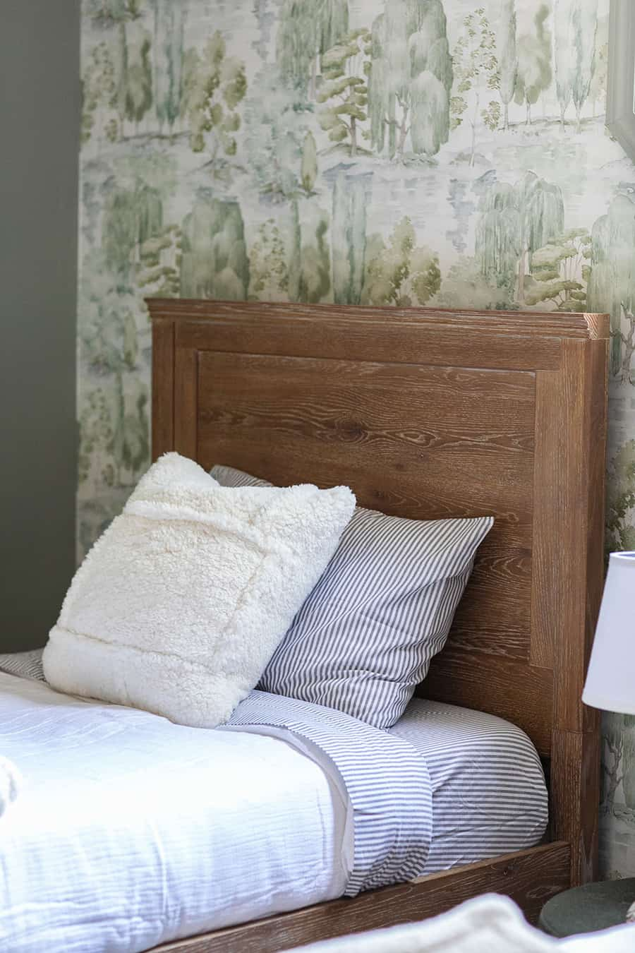 Wooden bed and bedding from Pottery Barn