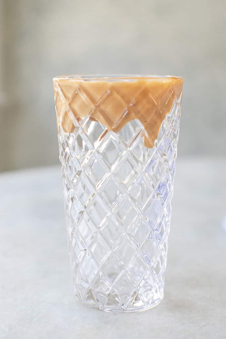 tall glass with a peanut butter rim