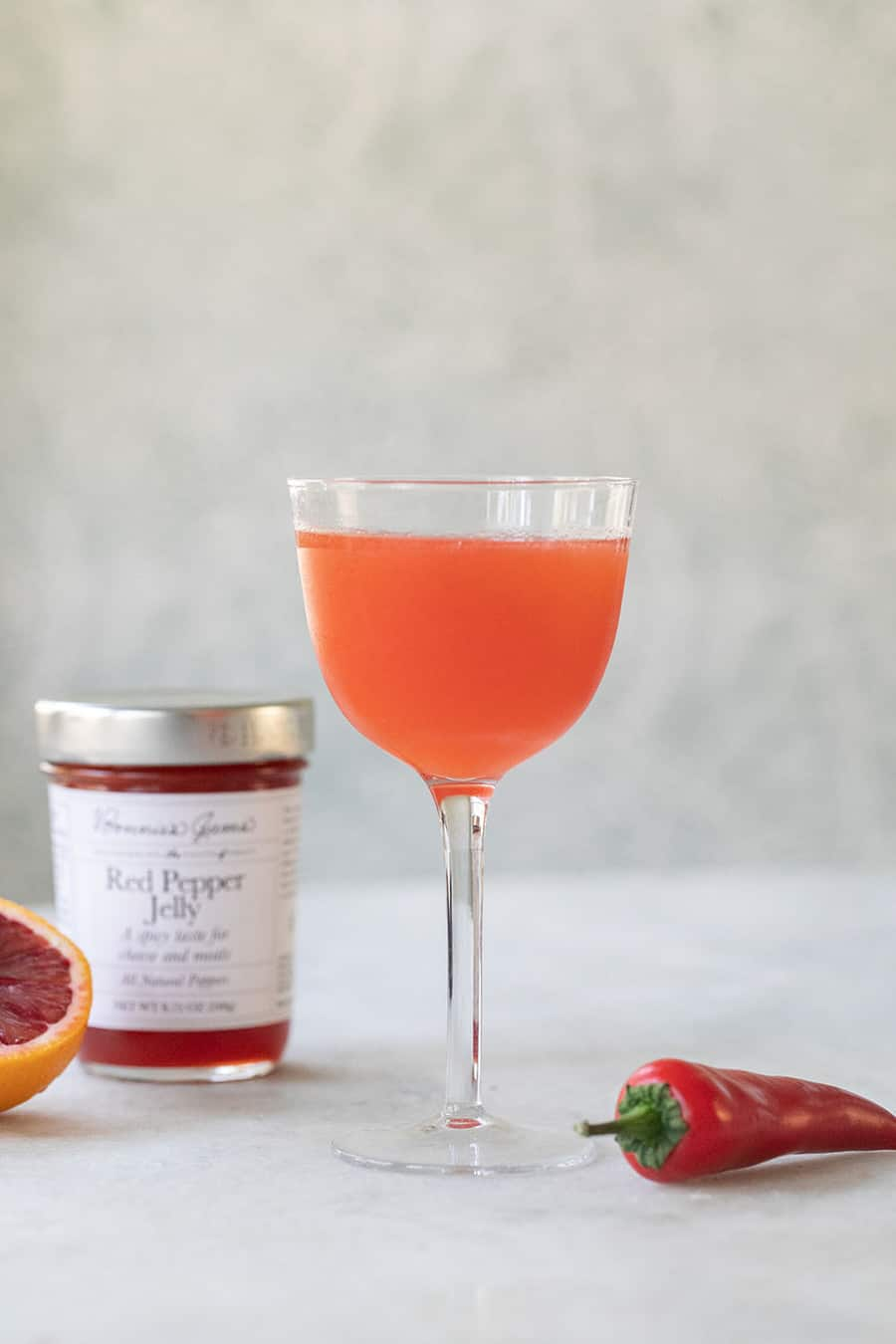 Red pepper jelly cocktail in a coupe glass