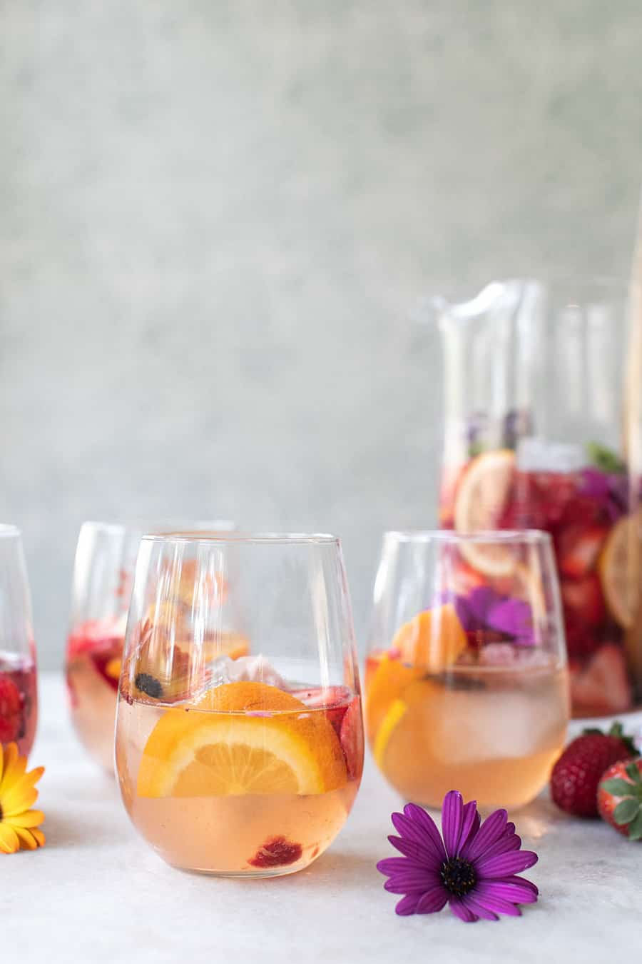 White sangria with oranges and flowers