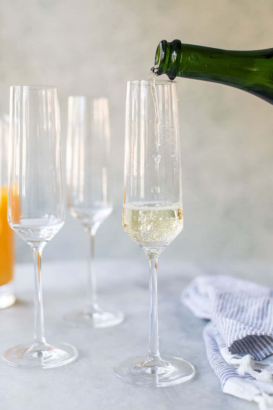 Sparkling white wine being poured into a Champagne Flute.