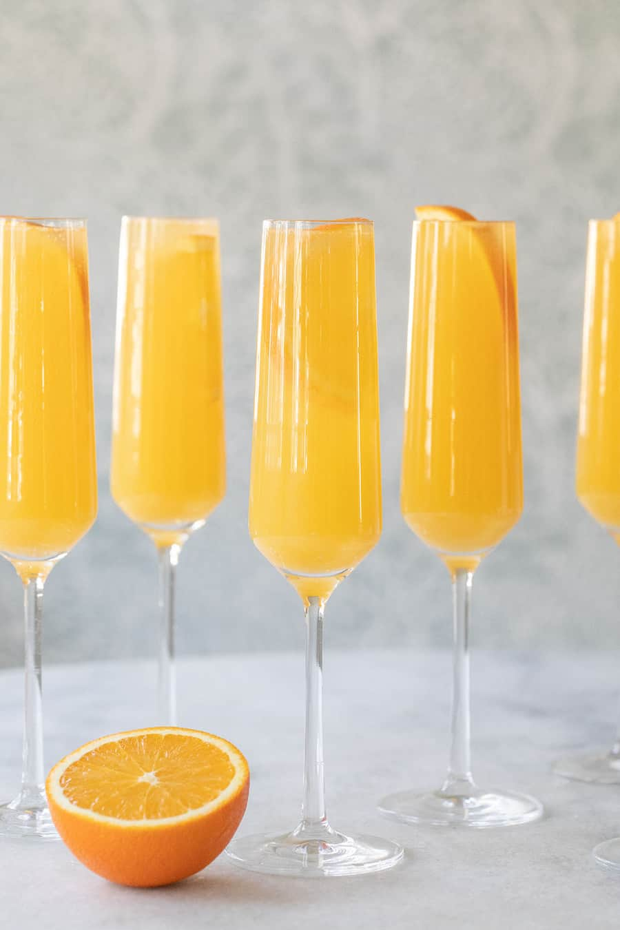 Mimosa in a glass with an orange