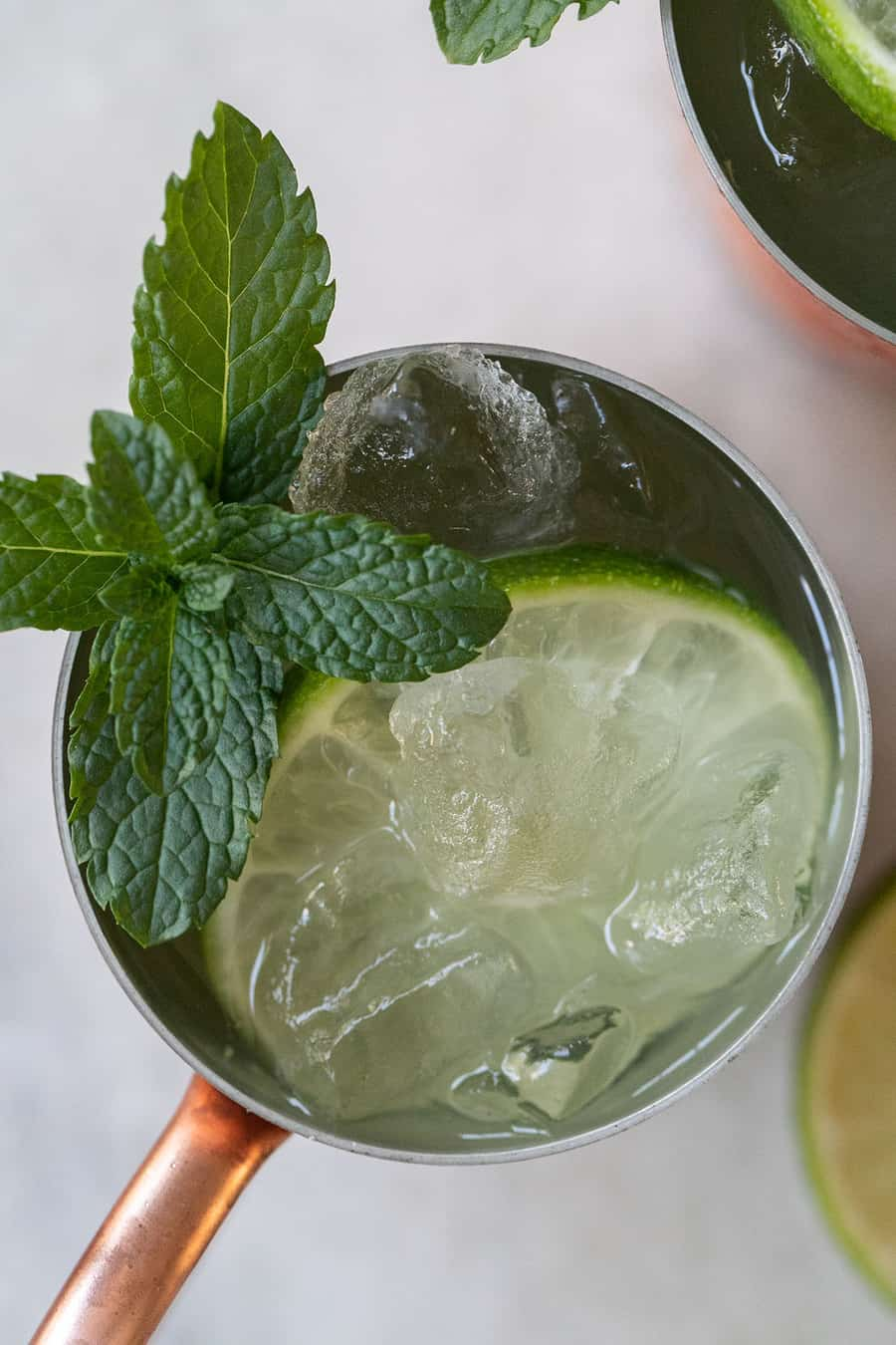 Refreshing cocktail with ice, lime and mint.