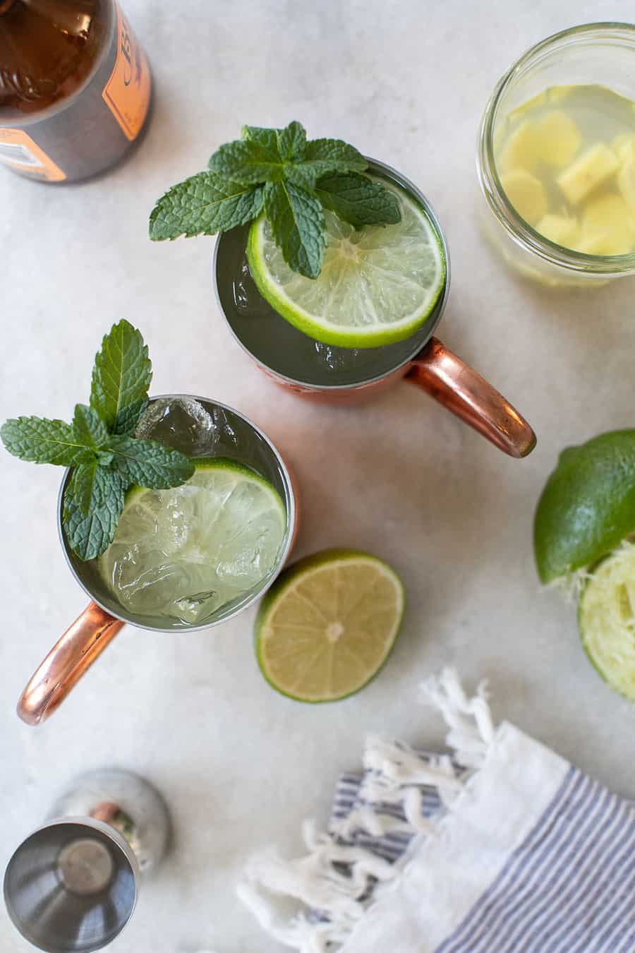 Moscow mule in a copper mug with lime and mint