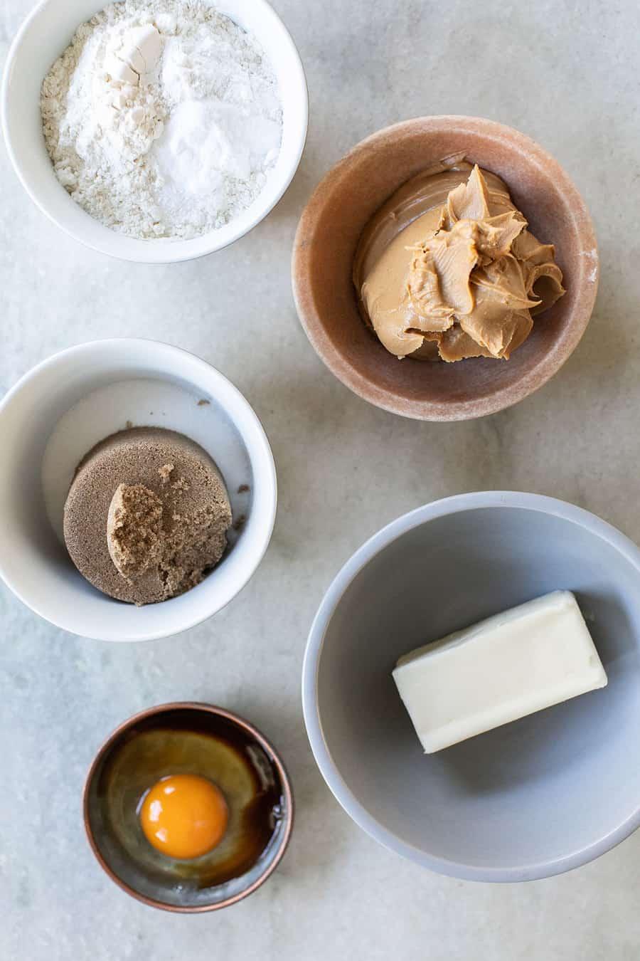 Brown Sugar, butter, egg vanilla, flour, baking soda, baking powder and salt in bowls.
