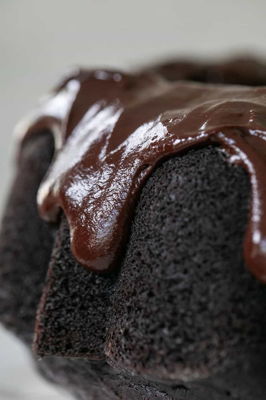 Chocolate bundt cake with dripping chocolate frosting.