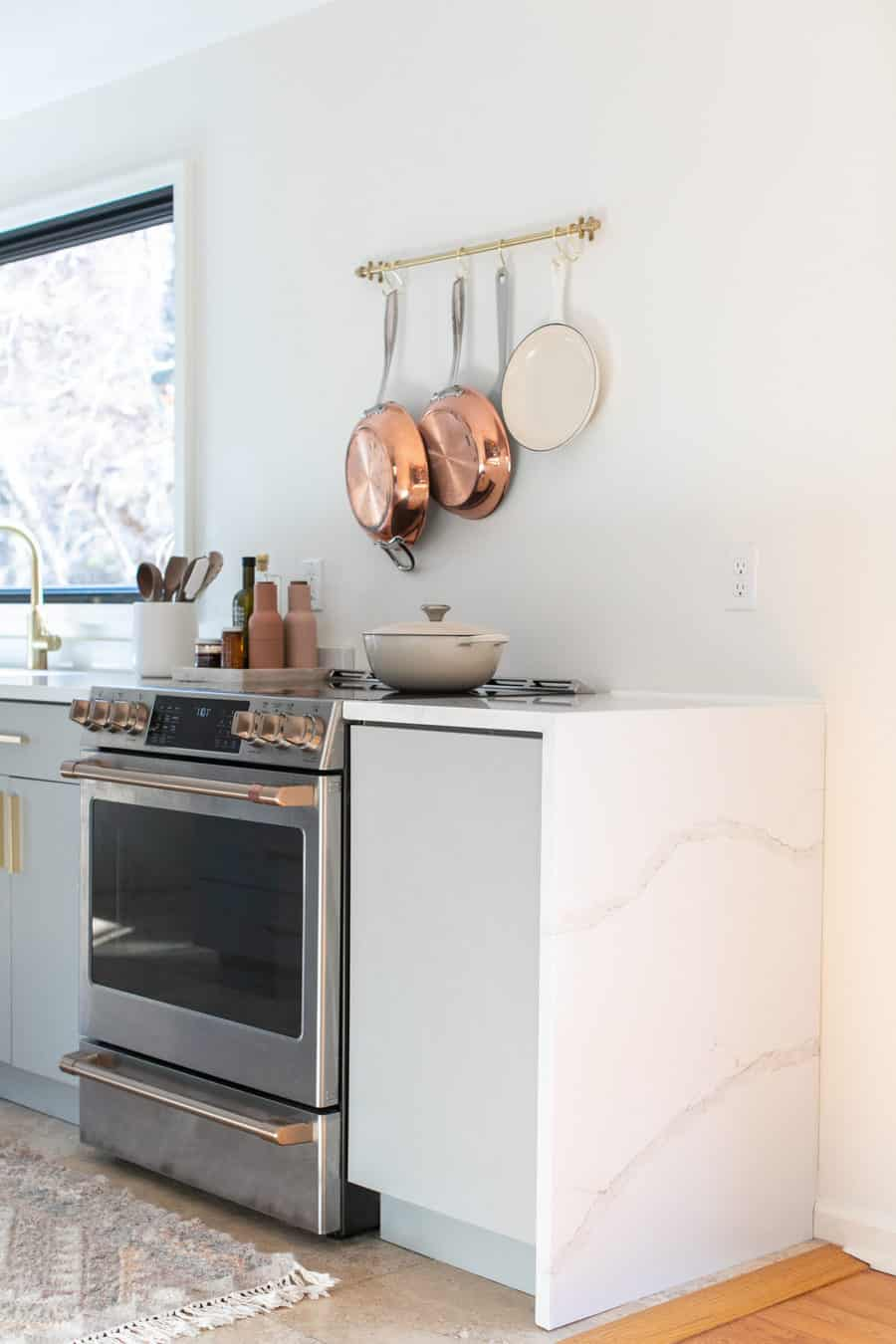 Small kitchen remodel with copper pots, cafe appliances