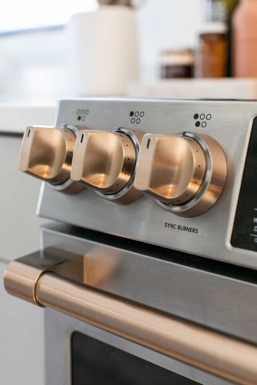 brush bronze handles on stainless steel range