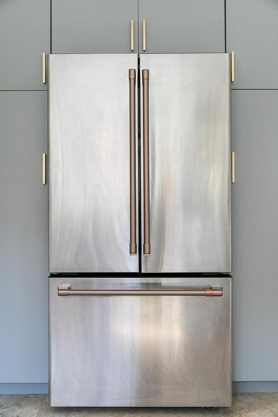 Cafe Appliances stainless steel refrigerator with brushed brass handles