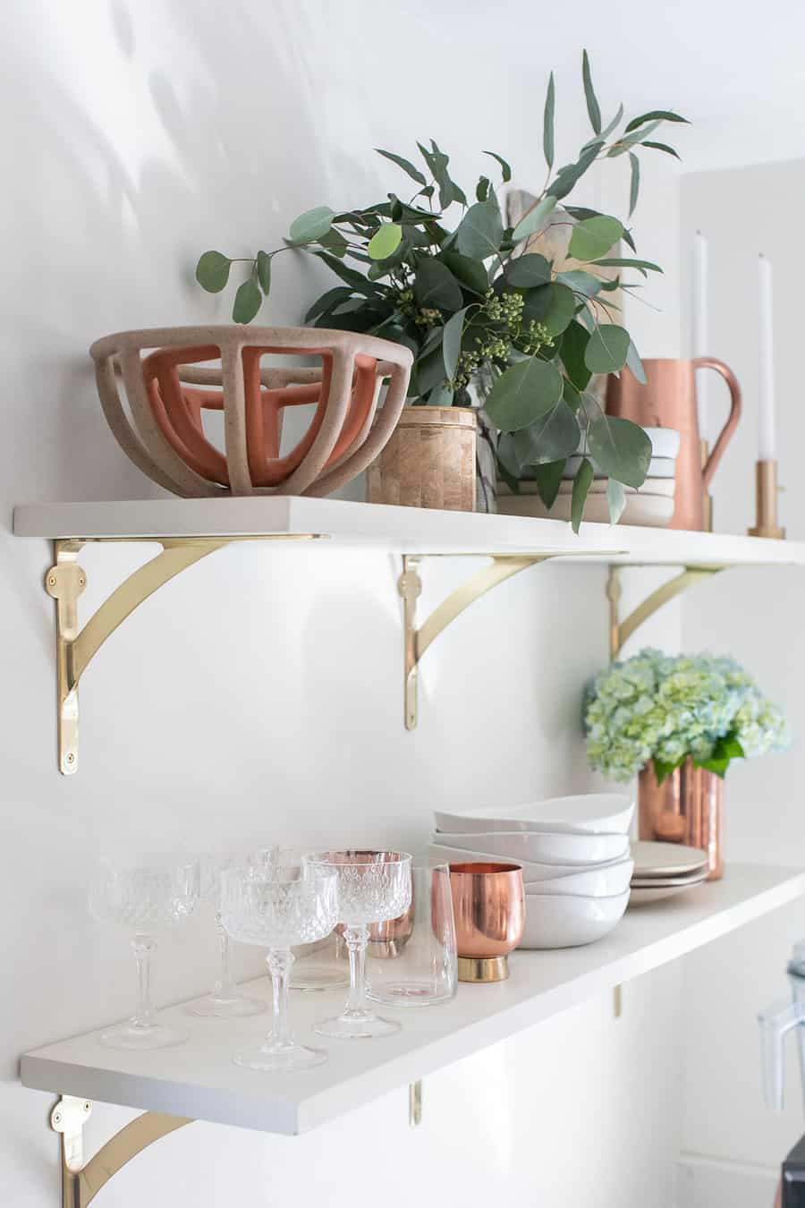 white open shelving with bowls, flowers, glasses and plates