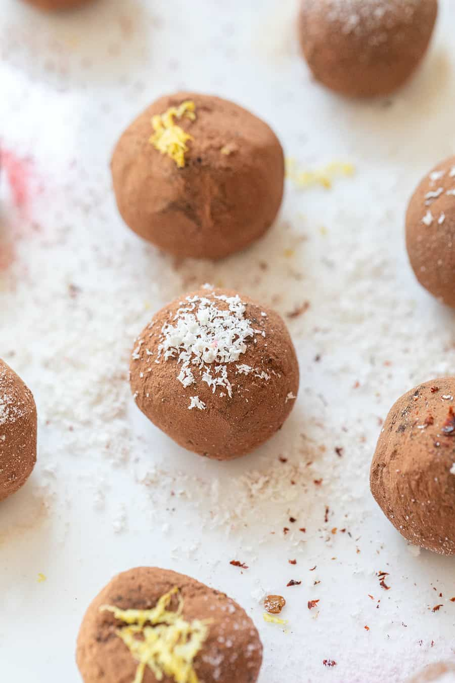 Chocolate truffles with white chocolate and lemon over the top