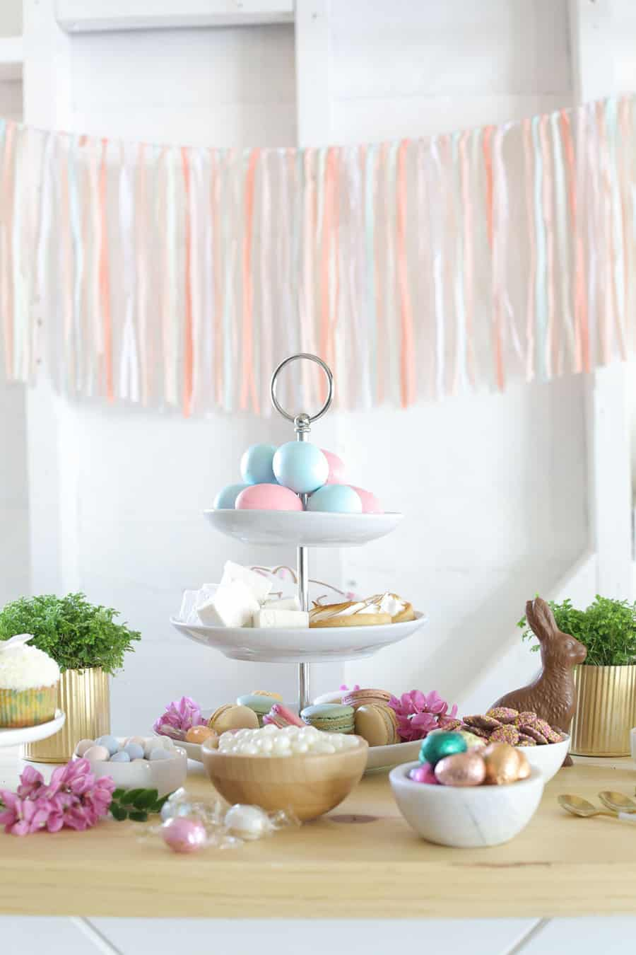 Easter dessert ideas on a table with chocolate, eggs, marshmallows.