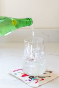 pouring Topo Chico over ice