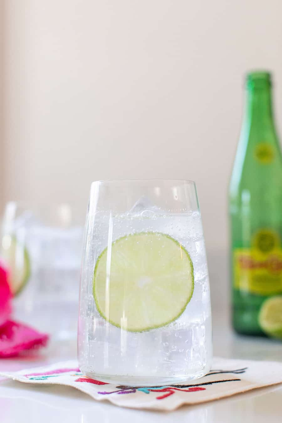 Ranch water in a glass with ice and lime slice