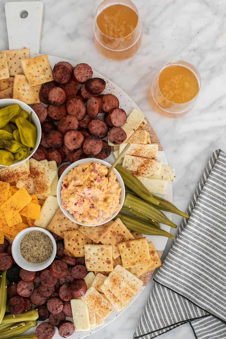 Charcuterie board with sausage and cheese